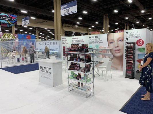10x20 Trade Show Booth Rental Package 220 - Front Angle View - Beauty Solutions - LV Exhibit Rentals in Las Vegas