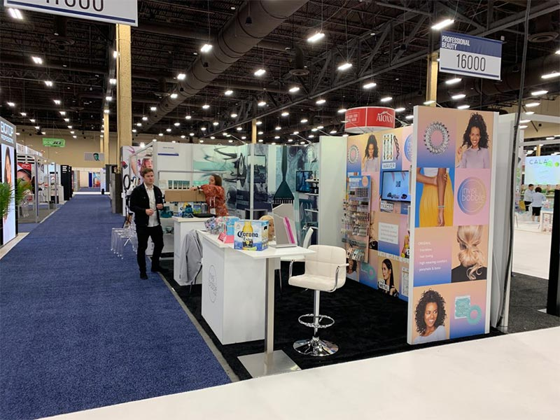 10x20 Trade Show Booth Rental Package 222 - Invisibobble and Urban Alchemy - LV Exhibit Rentals in Las Vegas