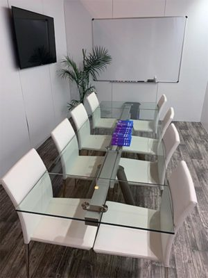 Delano Conference Table with White Diana Chairs - LV Exhibit Rentals in Las Vegas