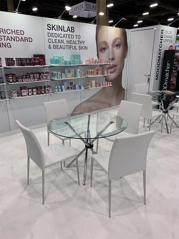 Glass Hydra Cafe Table with White Diana Chairs - LV Exhibit Rentals in Las Vegas