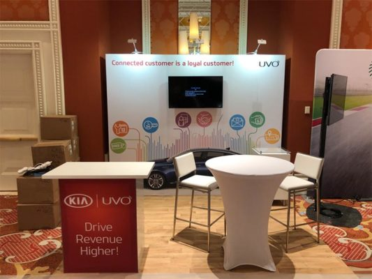 Kia Uvo - 10x10 Trade Show Booth Rental Package 105 Variation - LV Exhibit Rentals in Las Vegas