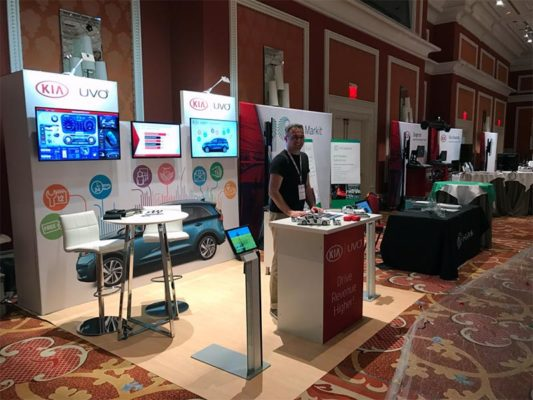 Kia Uvo - 10x10 Trade Show Booth Rental Package 115 - Angle - LV Exhibit Rentals in Las Vegas