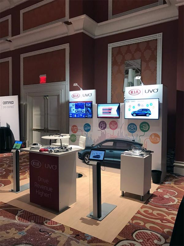 Kia Uvo - 10x10 Trade Show Booth Rental Package 115 - Front Angle - LV Exhibit Rentals in Las Vegas