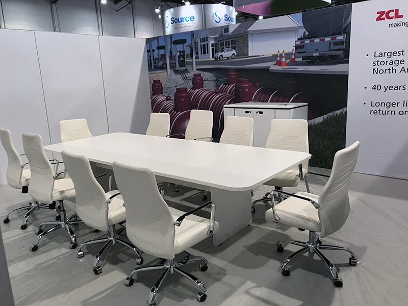 White 10ft Conference Table with White Fenella Office Chairs - LV Exhibit Rentals in Las Vegas