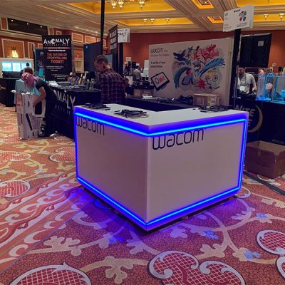 Trade Show Counter Rental Package C2 - LED L-Shaped Reception Counter - Wacom CES 2020 - LV Exhibit Rentals in Las Vegas